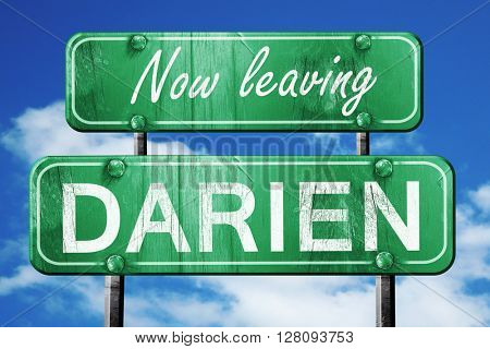 Leaving darien, green vintage road sign with rough lettering