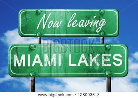 Leaving miami lakes, green vintage road sign with rough letterin