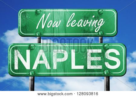 Leaving naples, green vintage road sign with rough lettering