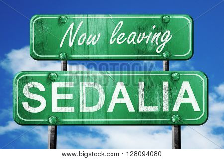 Leaving sedalia, green vintage road sign with rough lettering