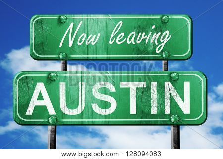 Leaving austin, green vintage road sign with rough lettering