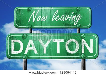 Leaving dayton, green vintage road sign with rough lettering