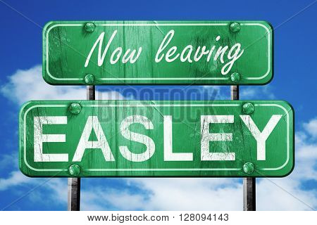 Leaving easley, green vintage road sign with rough lettering