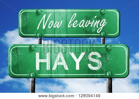 Leaving hays, green vintage road sign with rough lettering