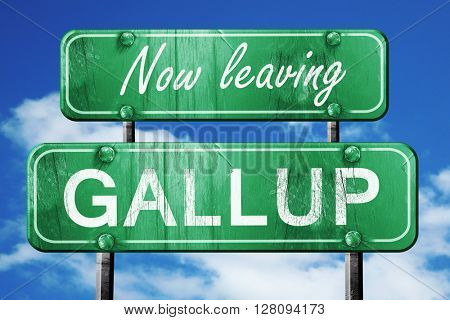 Leaving gallup, green vintage road sign with rough lettering