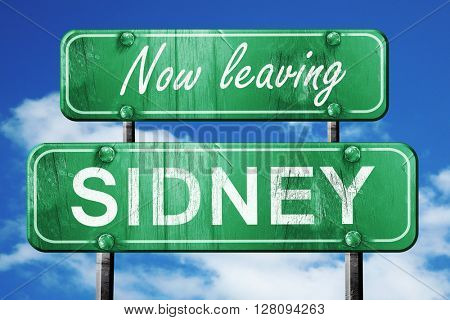 Leaving sidney, green vintage road sign with rough lettering