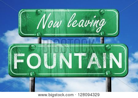 Leaving fountain, green vintage road sign with rough lettering