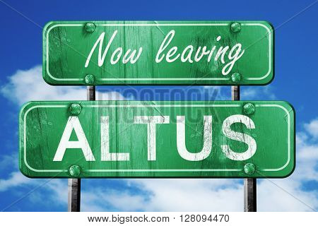 Leaving altus, green vintage road sign with rough lettering