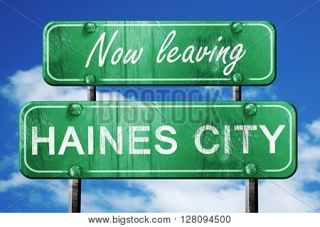 Leaving haines city, green vintage road sign with rough letterin