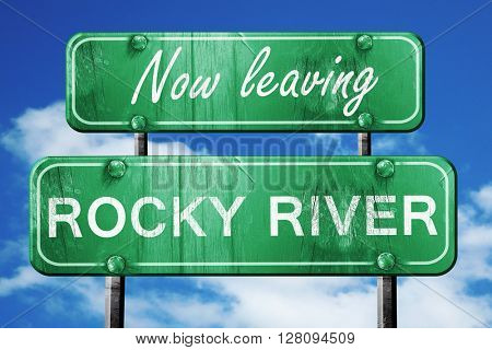 Leaving rocky river, green vintage road sign with rough letterin