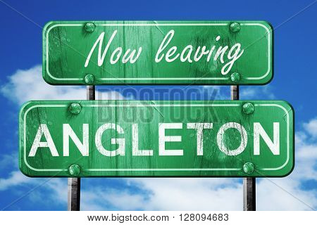 Leaving angleton, green vintage road sign with rough lettering