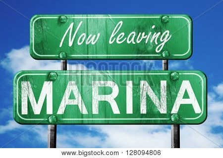 Leaving marina, green vintage road sign with rough lettering