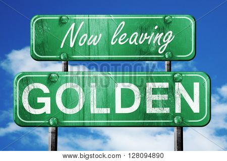 Leaving golden, green vintage road sign with rough lettering