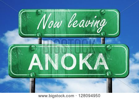 Leaving anoka, green vintage road sign with rough lettering