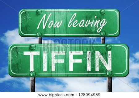 Leaving tiffin, green vintage road sign with rough lettering