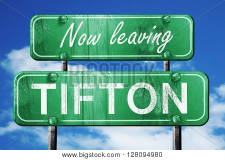 Leaving tifton, green vintage road sign with rough lettering