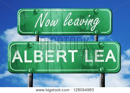 Leaving albert lea, green vintage road sign with rough lettering
