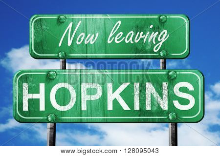 Leaving hopkins, green vintage road sign with rough lettering