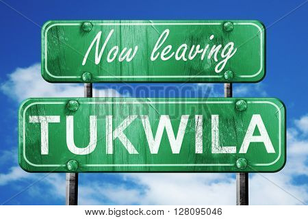Leaving tukwila, green vintage road sign with rough lettering