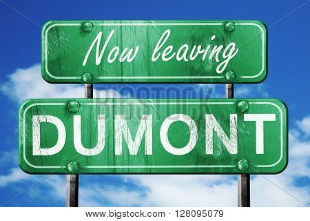 Leaving dumont, green vintage road sign with rough lettering