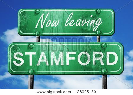Leaving stamford, green vintage road sign with rough lettering