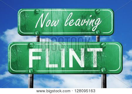 Leaving flint, green vintage road sign with rough lettering