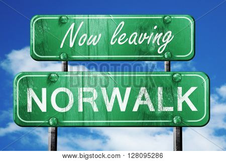 Leaving norwalk, green vintage road sign with rough lettering
