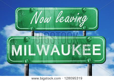 Leaving milwaukee, green vintage road sign with rough lettering