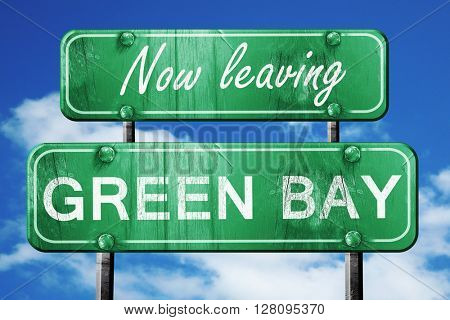 Leaving green bay, green vintage road sign with rough lettering