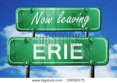 Leaving erie, green vintage road sign with rough lettering