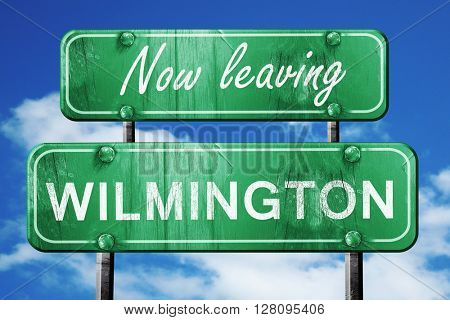 Leaving wilmington, green vintage road sign with rough lettering