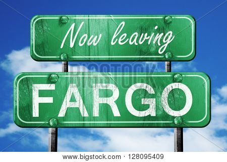 Leaving fargo, green vintage road sign with rough lettering
