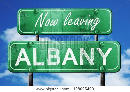 Leaving albany, green vintage road sign with rough lettering