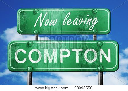 Leaving compton, green vintage road sign with rough lettering