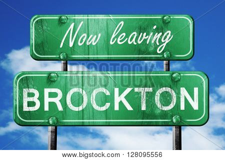 Leaving brockton, green vintage road sign with rough lettering