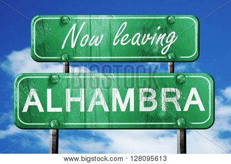 Leaving alhambra, green vintage road sign with rough lettering