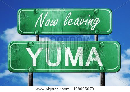 Leaving yuma, green vintage road sign with rough lettering