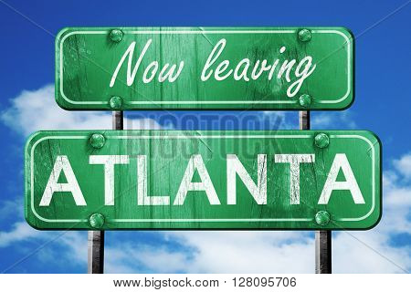 Leaving atlanta, green vintage road sign with rough lettering
