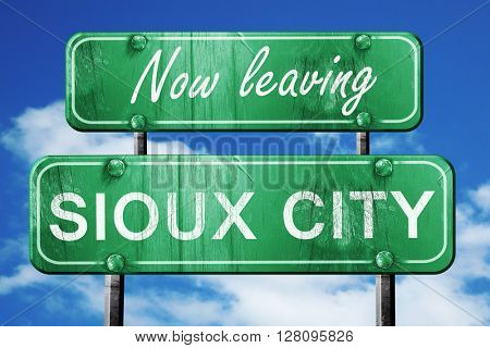 Leaving sioux city, green vintage road sign with rough lettering