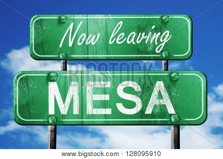 Leaving mesa, green vintage road sign with rough lettering