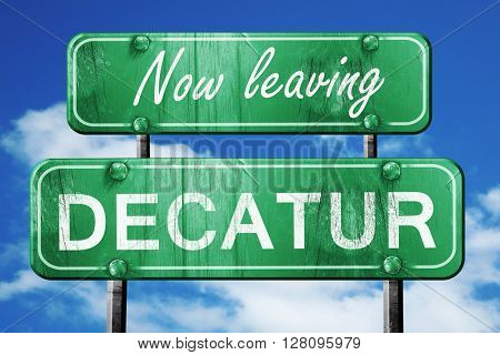 Leaving decatur, green vintage road sign with rough lettering