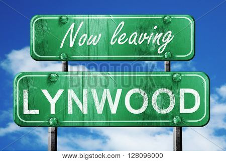 Leaving lynwood, green vintage road sign with rough lettering