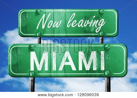 Leaving miami, green vintage road sign with rough lettering