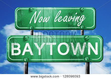 Leaving baytown, green vintage road sign with rough lettering