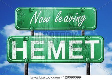 Leaving hemet, green vintage road sign with rough lettering