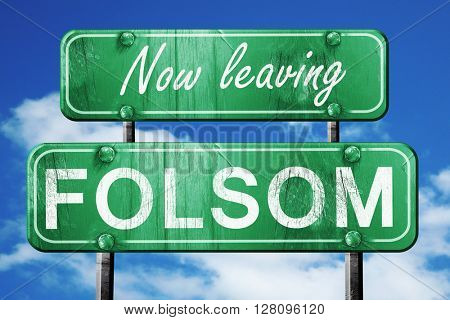 Leaving folsom, green vintage road sign with rough lettering