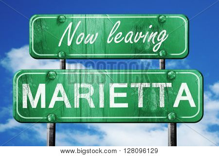 Leaving marietta, green vintage road sign with rough lettering
