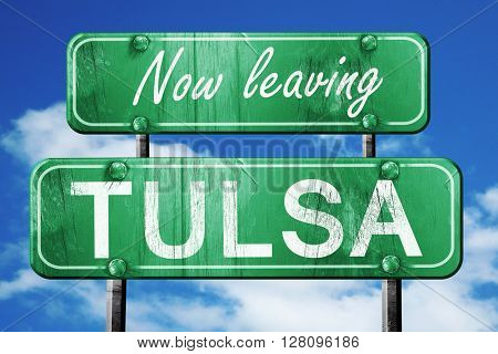 Leaving tulsa, green vintage road sign with rough lettering