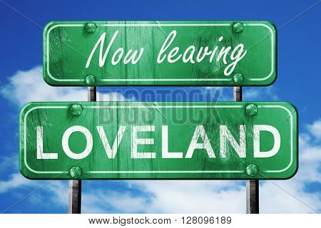 Leaving loveland, green vintage road sign with rough lettering