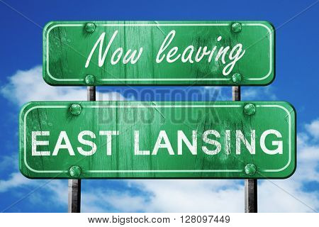 Leaving east lansing, green vintage road sign with rough letteri